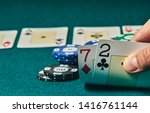 Small photo of Bad poker gamble or unlucky hand concept with player going all in with 2 and 7 (two and seven) offsuit also called unsuited, considered the worst hand in poker preflop (before the flop is revealed)