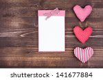 Notebook And Hearts On Wooden...