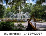 Woman Playing With Fountain In...