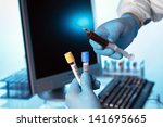 lab technician with a syringe...   Shutterstock . vector #141695665