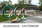 Small photo of TOKYO, JAPAN - 4 JUNE 2019 : The five ring symbol of the Olympic Games and view of the New National Stadium under construction for Tokyo Olympic 2020.