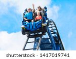 young family having fun riding... | Shutterstock . vector #1417019741