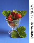 strawberries in the glass bowl... | Shutterstock . vector #141703924
