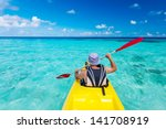 Young Caucasian Man Kayaking I...