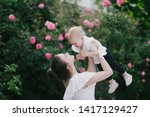 Portrait Of Young Mother With...