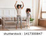 carefree funny african family... | Shutterstock . vector #1417300847