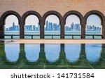 Stock photo doha skyline through the arches of the museum of islamic art doha qatar 141731584