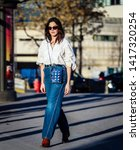 Small photo of PARIS, France- February 26 2019: Madelynn Furlong on the street during the Paris Fashion Week.