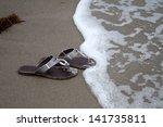 Flip Flops In The Beach Sand