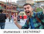Tourist Taking Selfie In Asia...