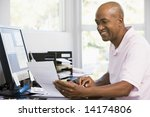 man in home office using... | Shutterstock . vector #14174806