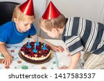 happy boys with a festive cake... | Shutterstock . vector #1417583537