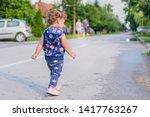 Toddler Walking On Road In...