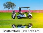 A Golf Cart And Golf Clubs Bag...