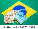 brazilian money bills on top of ... | Shutterstock . vector #1417813574