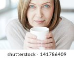 portrait of mature woman with... | Shutterstock . vector #141786409
