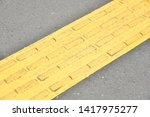 tactile paving is a system of... | Shutterstock . vector #1417975277