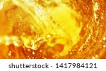 Small photo of Detail of beer beverages whirl, abstract fresh drink background