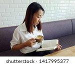 girl having a break with cup of ... | Shutterstock . vector #1417995377