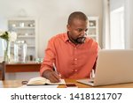 mature man working on laptop... | Shutterstock . vector #1418121707