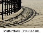 Wrought iron decorative fence with shadow