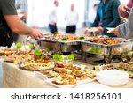 People Enjoying Buffet Food...