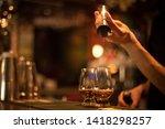 close up shot of a bartender... | Shutterstock . vector #1418298257