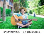 Boys Playing Guitar. Wearing A...