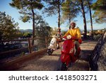 happy young couple riding on a... | Shutterstock . vector #1418503271