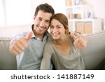 young couple showing thumbs up | Shutterstock . vector #141887149