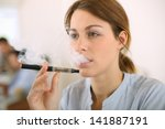 Portrait Of Woman Smoking With...