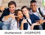 group of happy teenagers giving ... | Shutterstock . vector #141894295