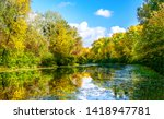 autumn forest river reflection... | Shutterstock . vector #1418947781