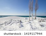 Winter Day At The Beach. Snowbank and ice piled up on the coast of Lake Michigan at Sleeping Bear Dunes National Lakeshore in Michigan.