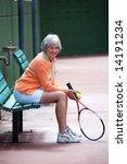 Active senior on the tennis court. - stock photo