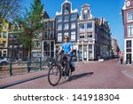 man riding a bicycle in... | Shutterstock . vector #141918304