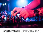 Stock photo close up of dj hands mixing music on a mix table dj in a night club controlling the music music 1419467114
