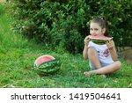 happy little child girl eating... | Shutterstock . vector #1419504641