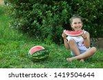 happy little child girl eating... | Shutterstock . vector #1419504644