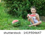 happy little child girl eating... | Shutterstock . vector #1419504647