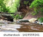 Nature Blurred Background with water flowing and reflections in Sedona, Arizona at West Fork Trail.