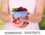 woman hands holding bowl of... | Shutterstock . vector #141970471