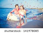 the bride and groom in their... | Shutterstock . vector #141978085