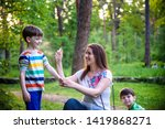 young woman mother applying... | Shutterstock . vector #1419868271