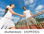tennis players giving handshake | Shutterstock . vector #141992521