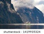tourist boat cruising in... | Shutterstock . vector #1419935324