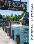 Small photo of Leland, MI / USA - June 9, 2019: The historic district of Leland, MI, also known as Fishtown, old buildings originally used to process fresh caught fish, now a collection of quaint shops and boutiques