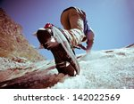 climber climbs on ice. | Shutterstock . vector #142022569