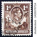 Small photo of ZAGREB, CROATIA - JUNE 2, 2019: a stamp printed in Northern Rhodesia shows King George VI, circa 1938