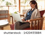 woman working on a laptop on a... | Shutterstock . vector #1420455884